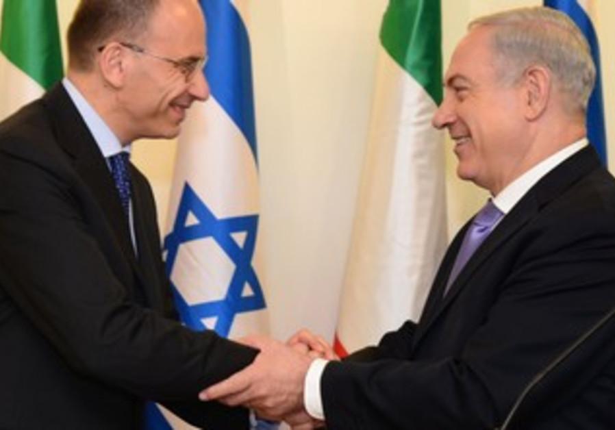 Netanyahu shakes hands with Italian Prime Minister Enrico Letta.
