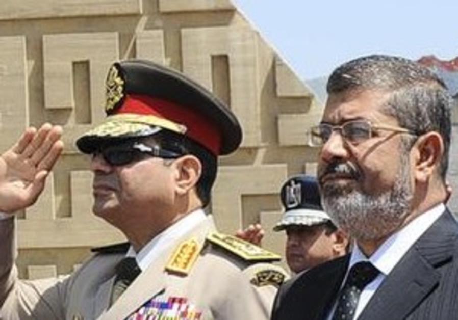 Egypt'sChief of Staff Abdel Fattah al-Sisi (R) and Egyptian President Mohamed Morsi in April, 2013.