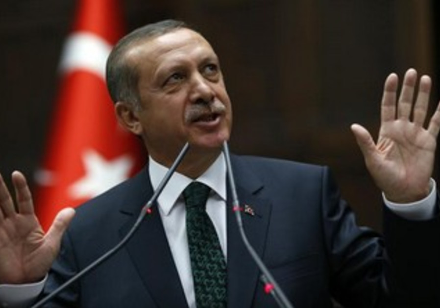 Turkey's Prime Minister Tayyip Erdogan addresses members of parliament from his ruling AK Party