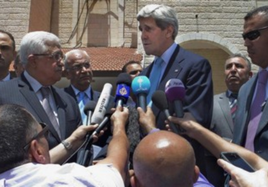 Kerry, with Abbas, makes a short statement for reporters during recent visit.