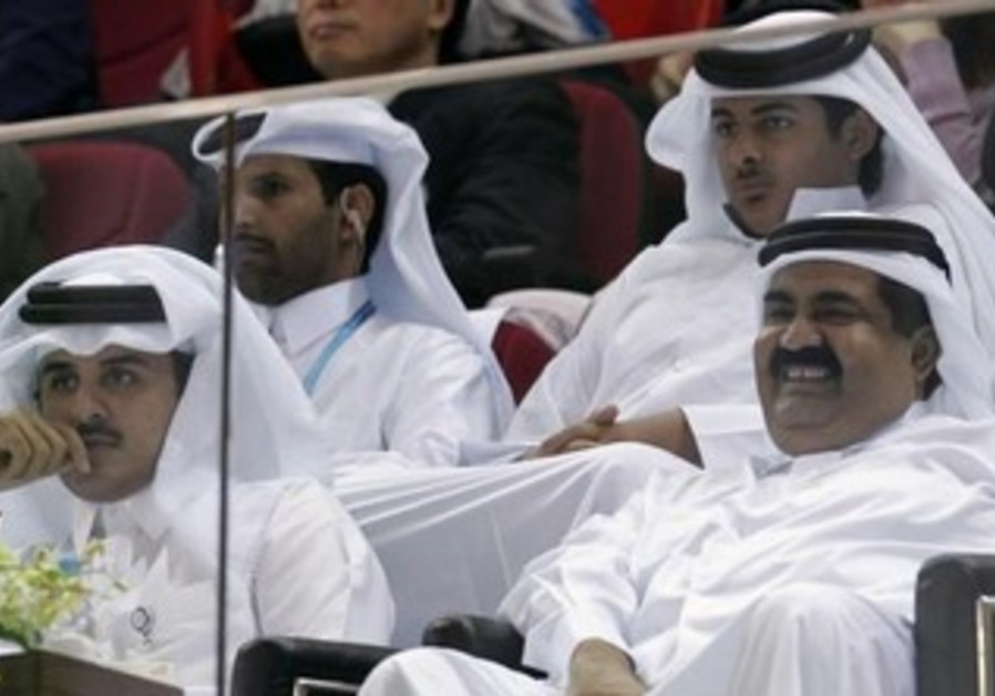 Qatar's Emir Sheikh Hamad Bin Khalifa Al-Thani (R) and Heir Apparent Sheikh Tamim Bin Hamad Al-Thani