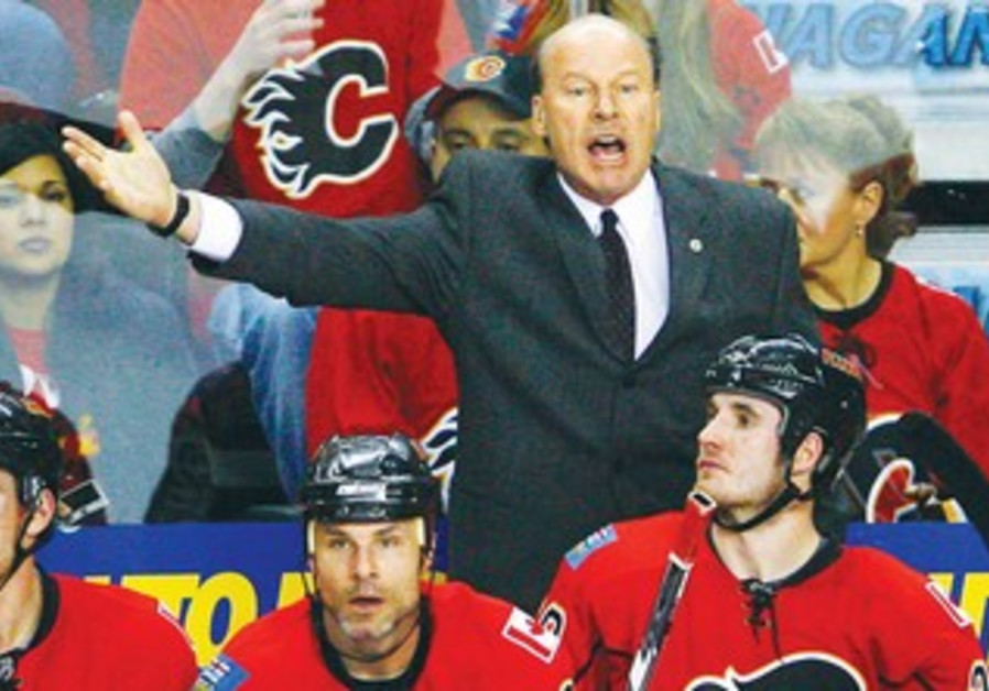 Mike Keenan (in suit) will coach Canada in next month's Maccabiah ice hockey tournament.