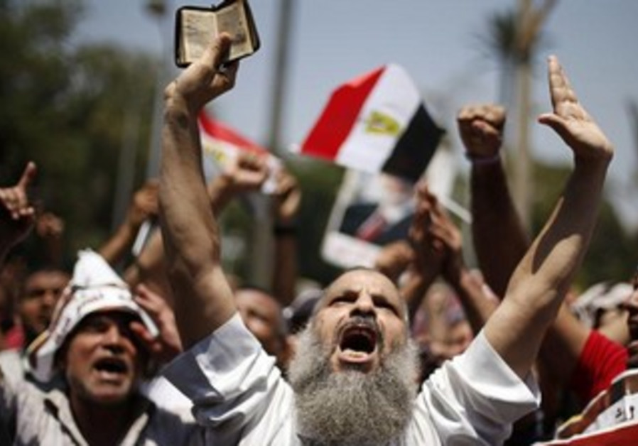 A supporter of former Egyptian president Mohamed Morsi during a rally in Cairo July 5, 2013.