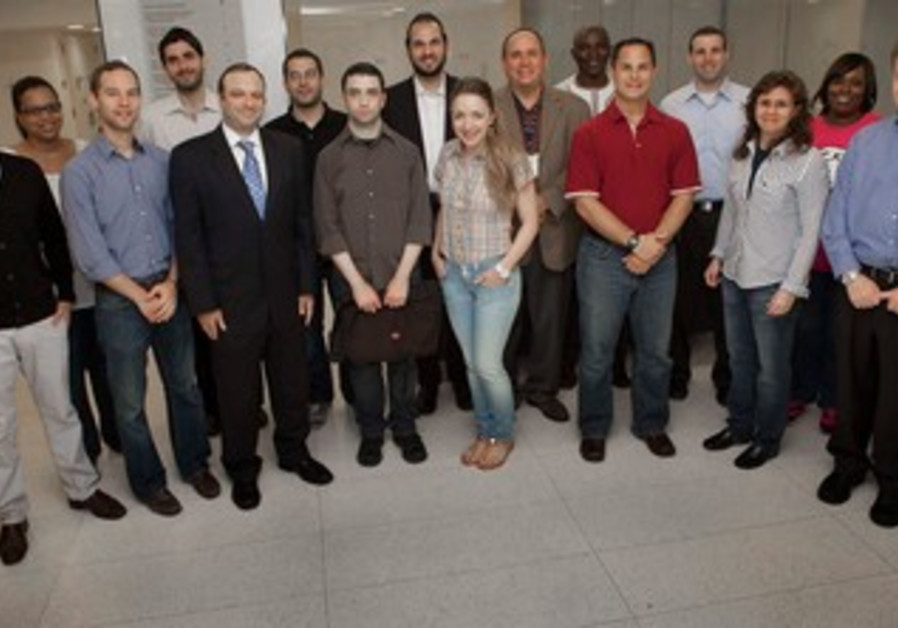 MBA students from Yeshiva University pose with Prof. Steven Nissenfeld.