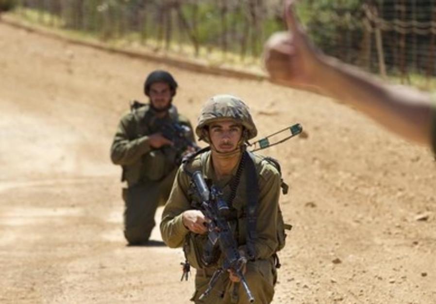 Israeli soldiers patrol along Israel's border with Lebanon.
