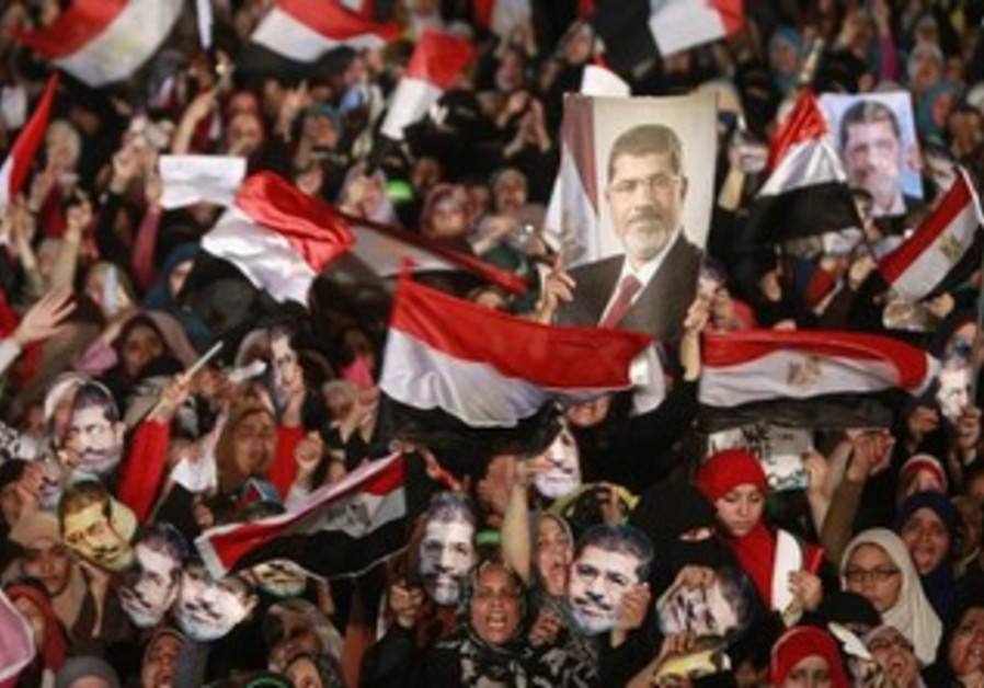 Supporters of Mohamed Morsi gather at the Rabaa Adawiya square, where they are camping, in Cairo