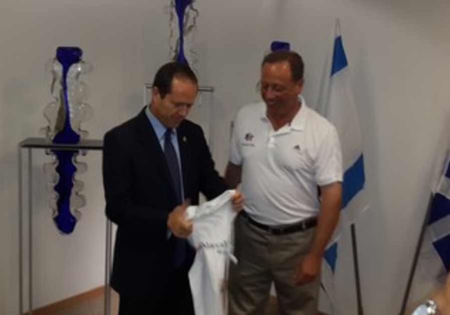 Nir Barkat gets ready for the Maccabiah.