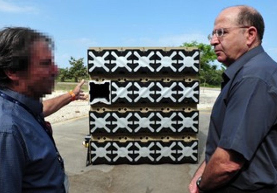Defense Minister Yaalon meets with Rafael expert.