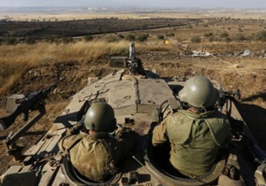 IDF troops survey the Golan Heights.