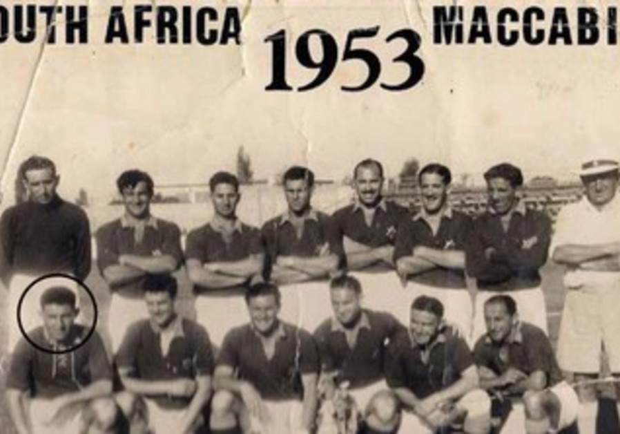 Hilly Linde winning a Maccabiah medal in 1953 as South African soccer player