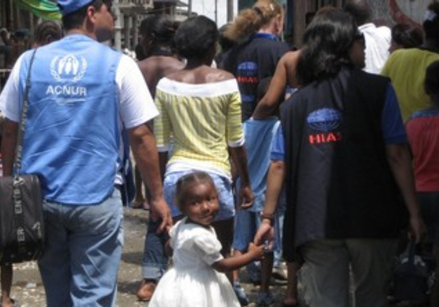 A young girl in Ecuador holding hands with HIAS