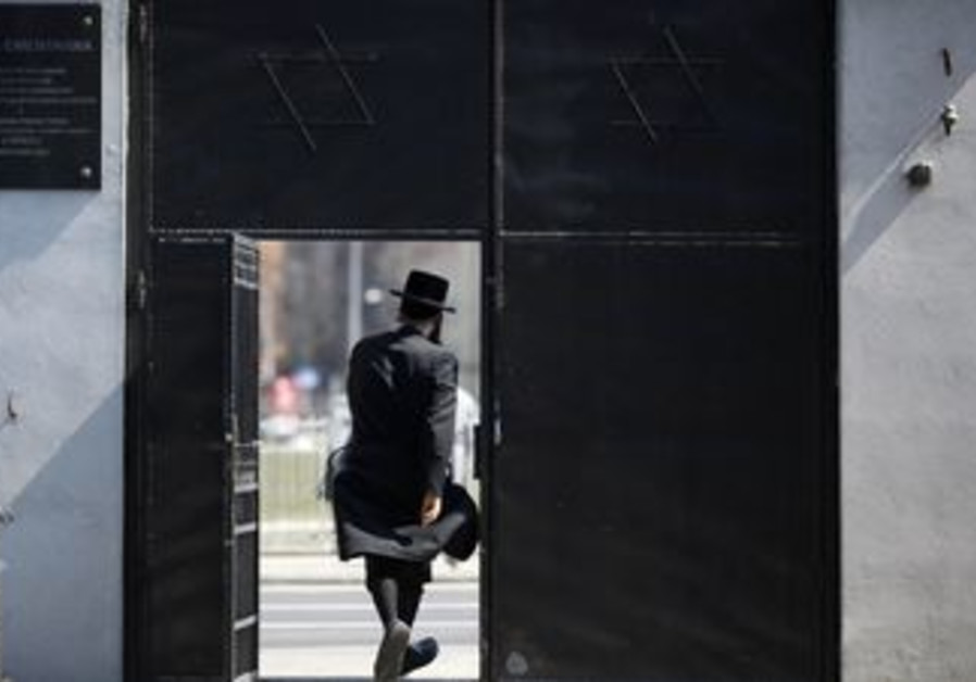 Haredi man leaves the Jewish Cemetery in Warsaw
