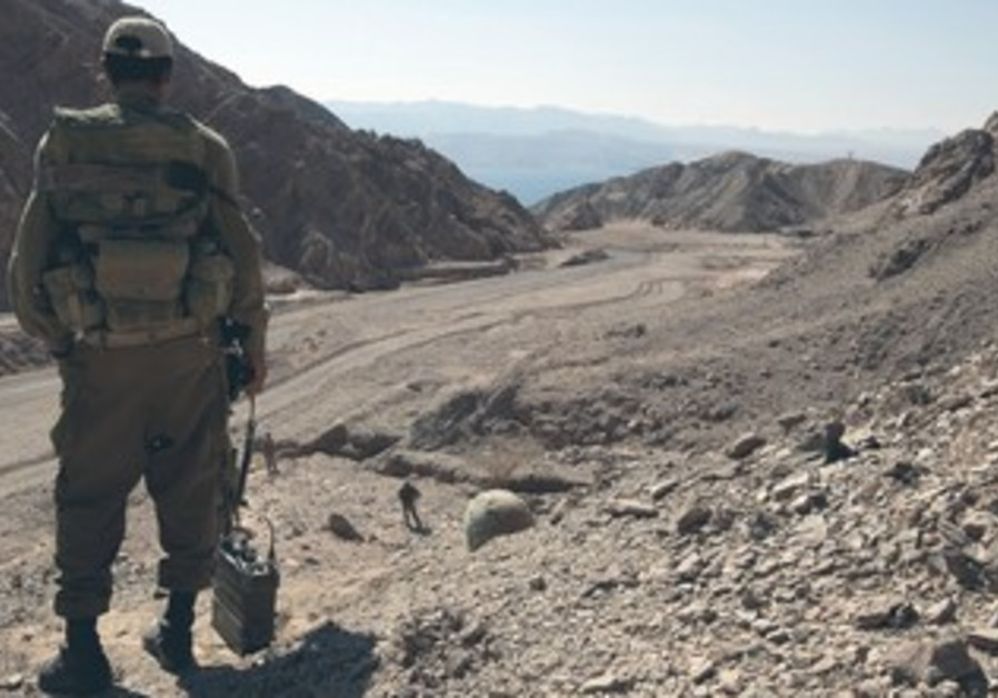 AN IDF soldier stands guard near the Israeli-Egyptian border.