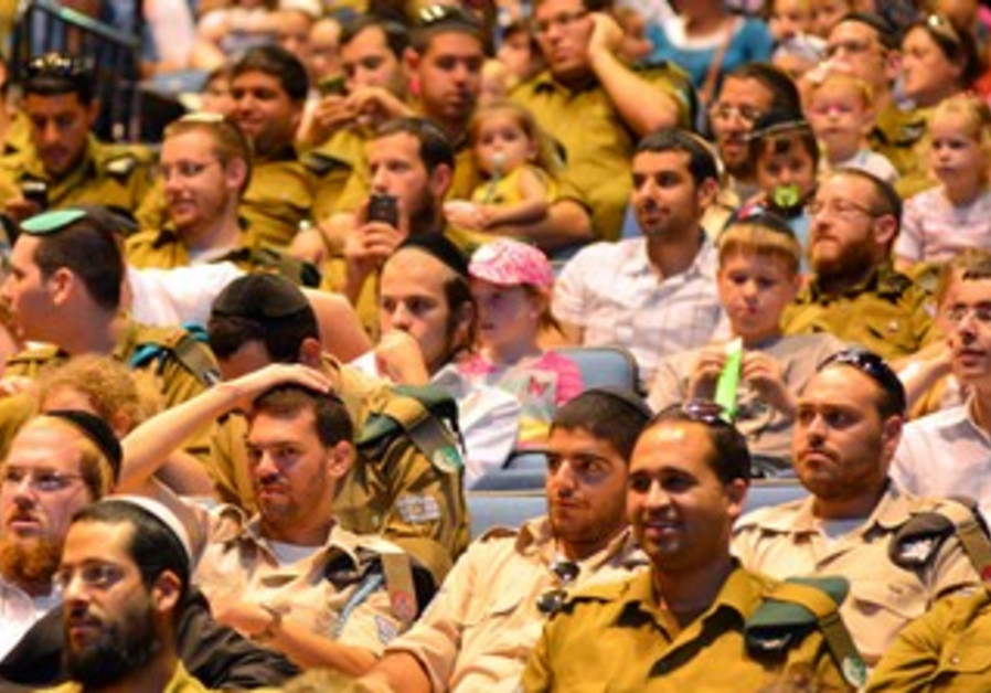 Haredi soldiers and their families attend event honoring them in Haifa, July 22, 2013.