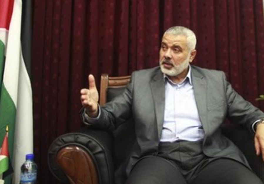 Hamas leader Ismail Haniyeh gestures during an interview with Reuters in Gaza City May 10, 2012.