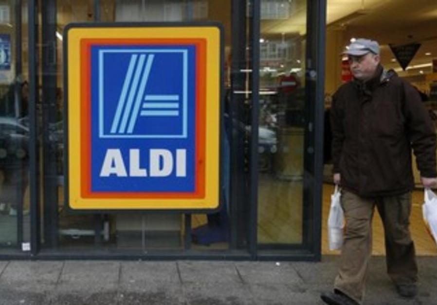 A customer leaves an Aldi supermarket, February 9, 2013