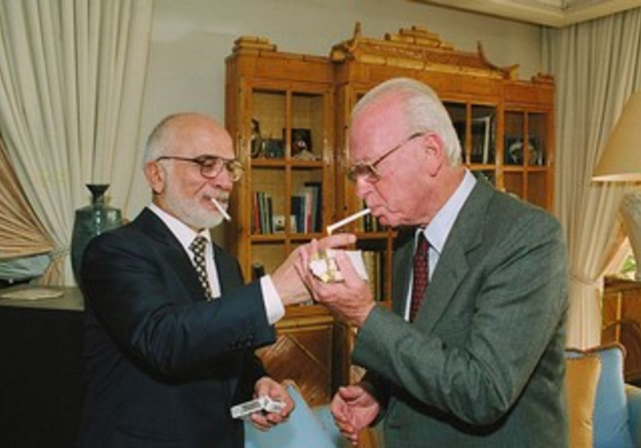 King Hussein of Jordan lights P.M.Yitzhak Rabin's cigarette at royal residence in Aqaba.