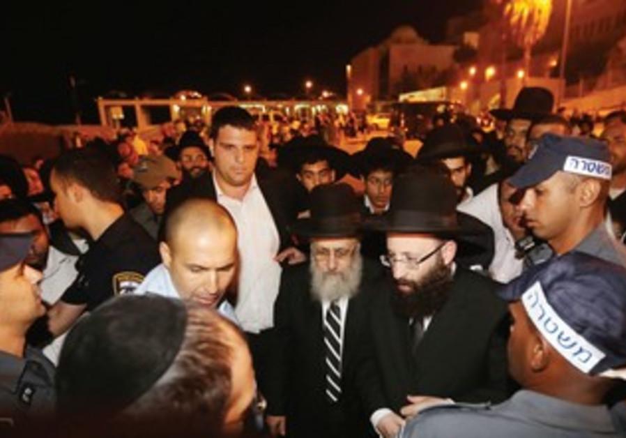 POLICE ESCORT newly elected Sephardi Chief Rabbi Yitzhak Yosef to the Western Wall.