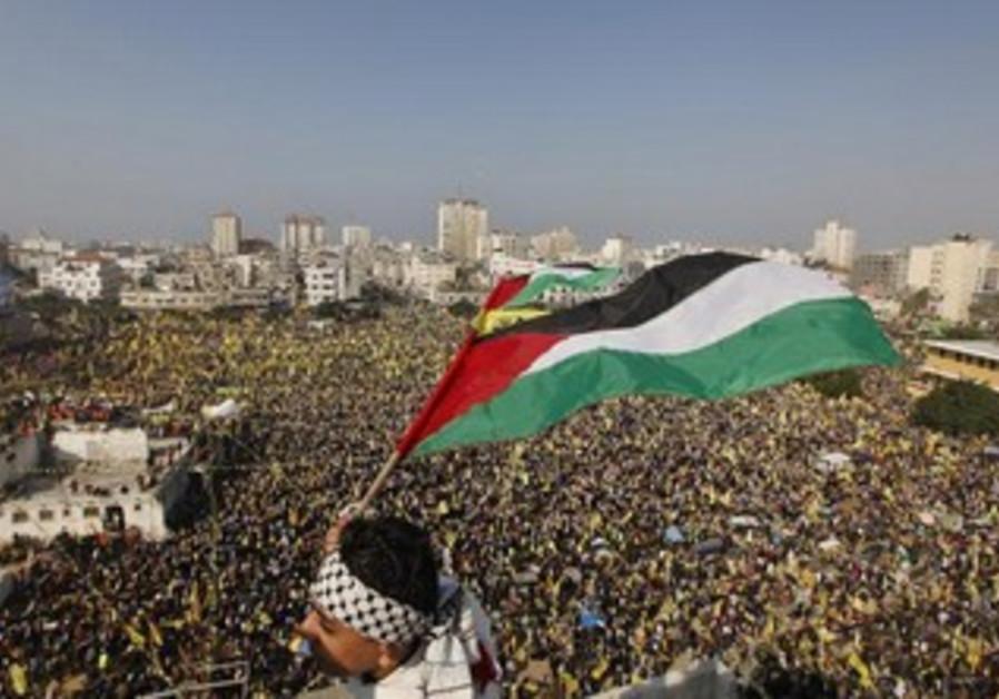 Palestinians in Gaza celebrate the founding of Fatah