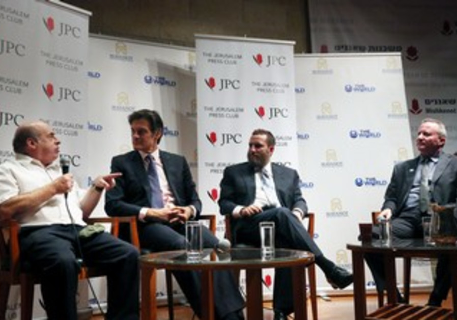 Dr. Mehmet Oz and Rabbi Shmuley Boteach at a panel debate Monday at the Jerusalem Press Club.