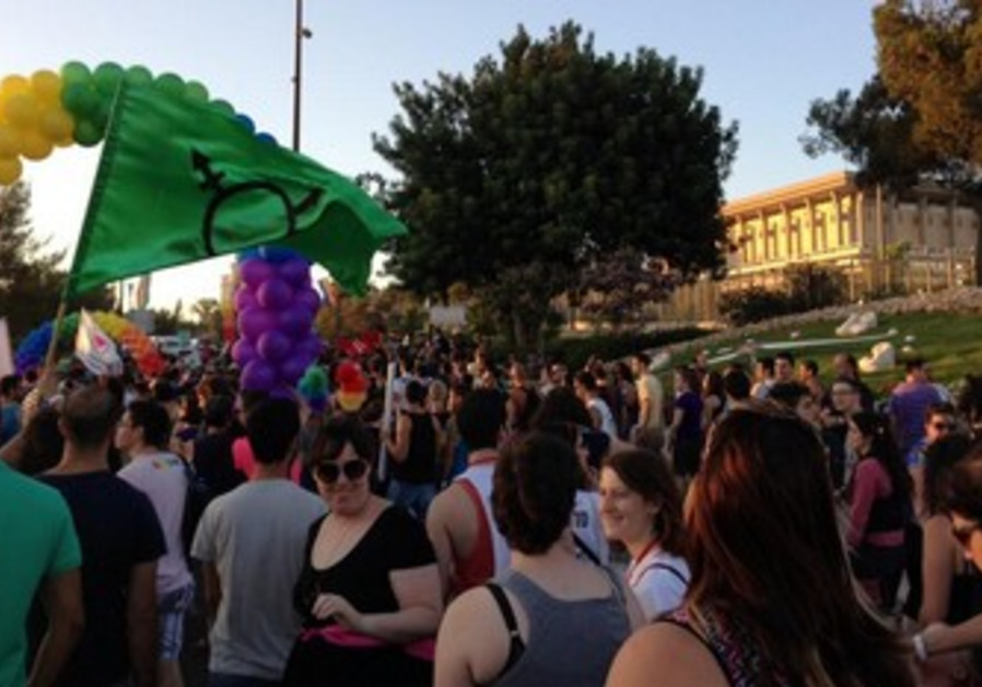 Marching by the Knesset for Jerusalem's Gay Pride parade, August 1, 2013.