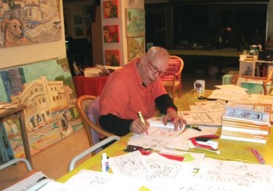 YAAKOV (DRY BONES) KIRSCHEN is hard at work in his home studio.