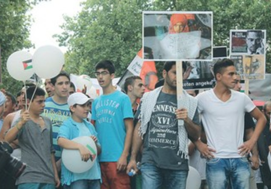MARCHERS AT an al-Quds Day rally in Berlin yesterday call for the destruction of Israel, August 2013