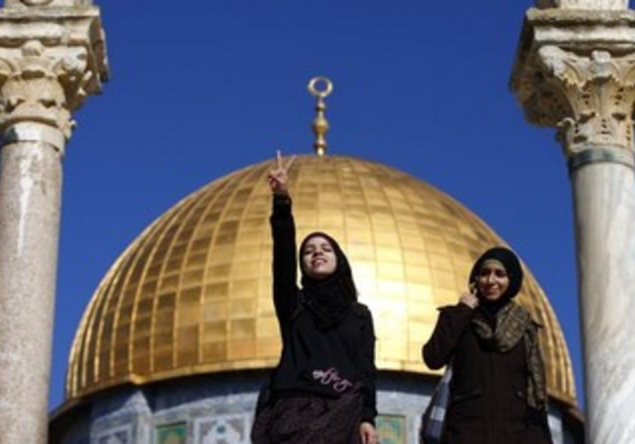 A Palestinian youth gestures in front of the Dome of the Rock t in Jerusalem's Old City.