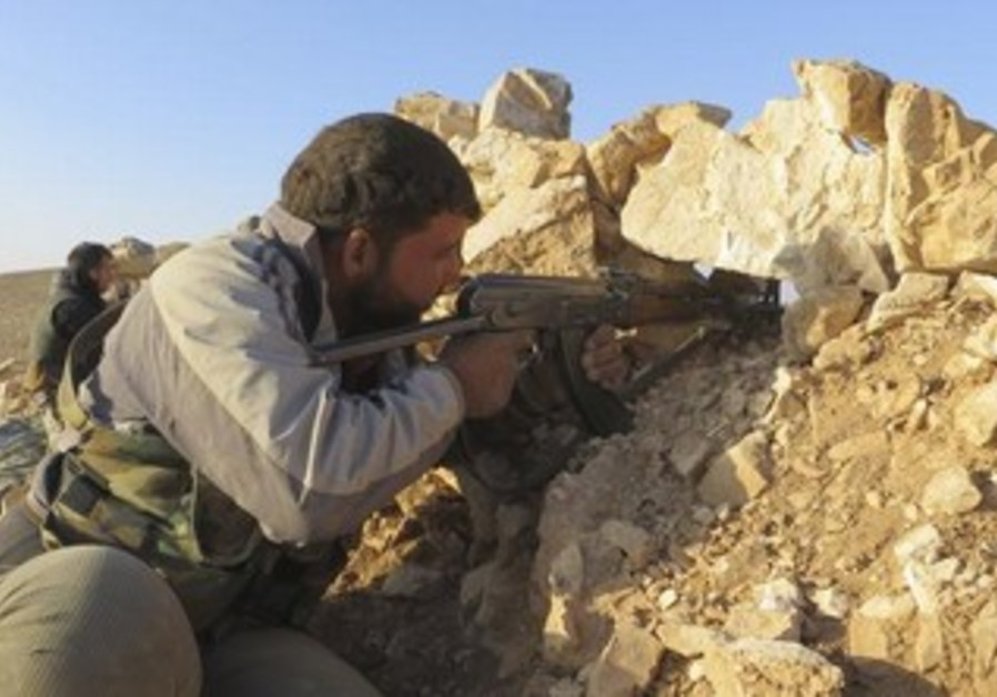 Free Syrian Army fighter takes position in Deraa, June 17, 2013.