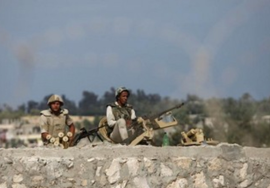 Egyptian soldiers keep guard in Sinai