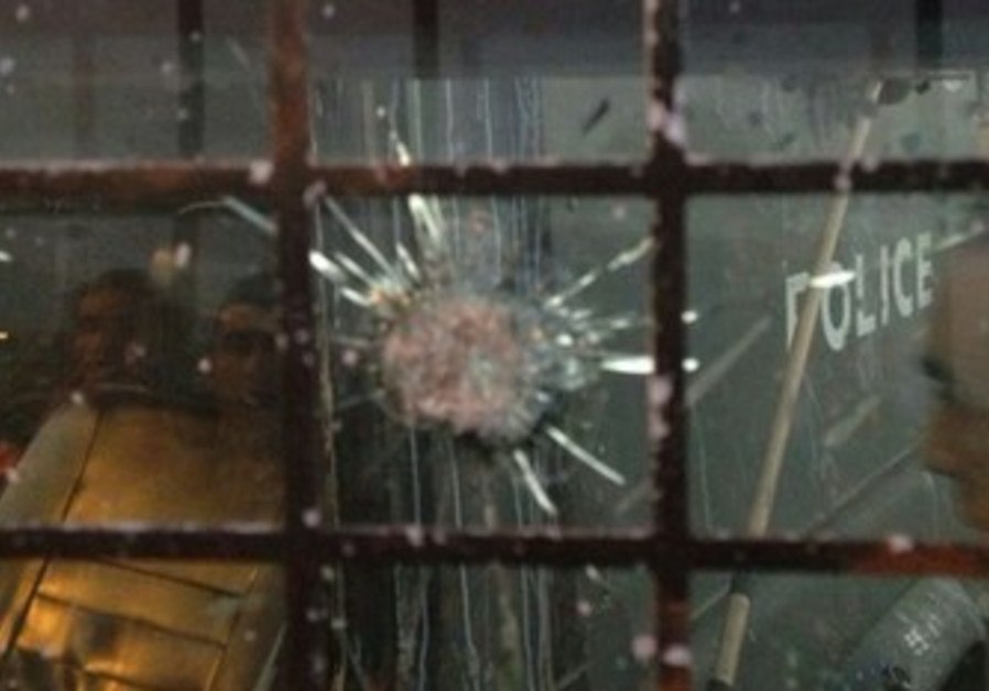 Shattered window of security forces vehicle that came under fire in Jenin