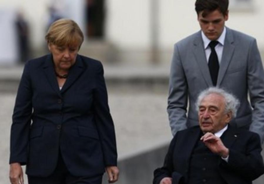 German Chancellor Angela Merkel speaks with Max Mannheimer, a Holocaust survivor, at Dachau.