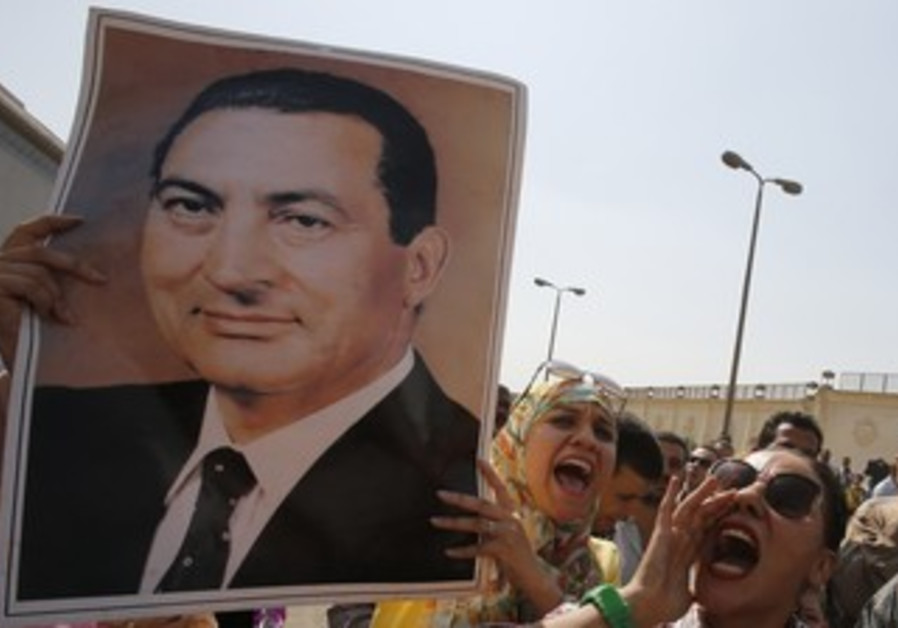 Supporters of Mubarak celebrate his release in front of Tora prison near Cairo August 22