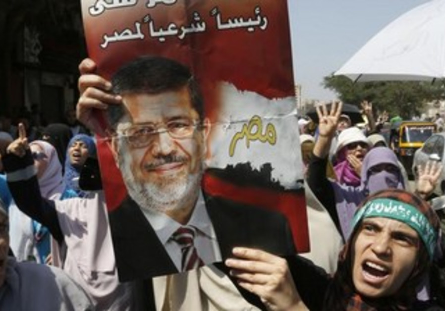 Supporters of deposed Egyptian President Mohamed Morsi march in Cairo, August 23, 2013.