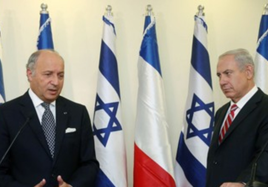 Prime Minister Binyamin Netanyahu with French Foreign Minister Laurent Fabius.