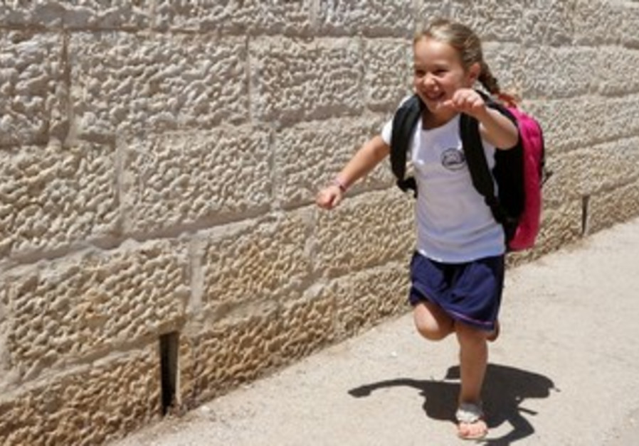 Miki Katz prepares for her first day of school to kita alef, 26 August 2013.