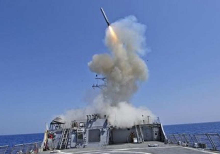 The guided-missile destroyer USS Barry launches a Tomahawk cruise missile.
