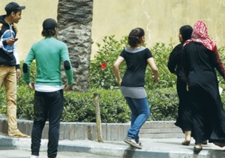 EGYPTIAN MEN harass women on the streets of Cairo in April.
