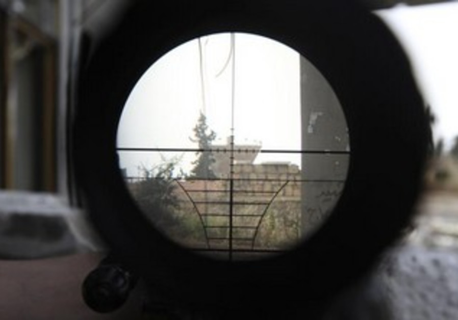 A Syrian regime gathering point is seen through a sniper scope