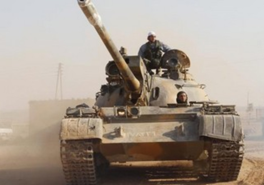 Free Syrian Army fighter drives a tank