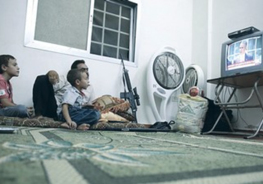 Free Syrian Army fighter watching Obama speech on Syria, August 31, 2013.