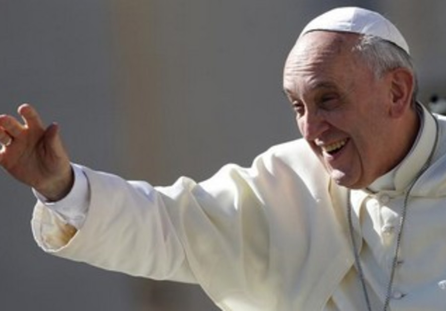 Pope Francis waves at the Vatican September 4, 2013.