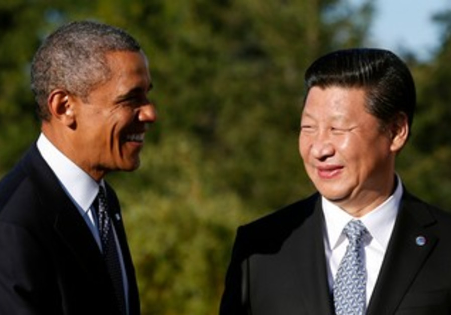 US President Barack Obama shakes hands as he meets with China's President Xi Jinping.