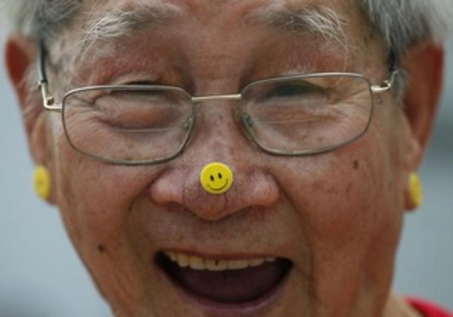 "A man practices Laughter Yoga during the ""World Laughter Day"""