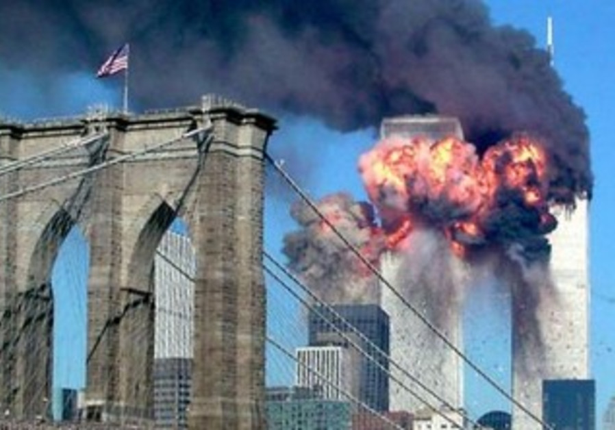 The World Trade Center burns in the aftermath of the Septembe 11, 2001 terror attacks.