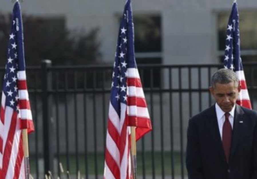 U.S. President Barack Obama bows his head during a prayer at remembrance ceremonies for 9/11