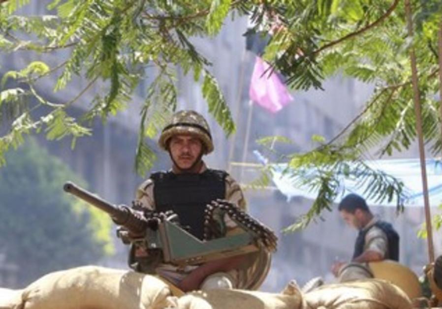 A soldier mans a machine gun in Cairo September ll, 2013.