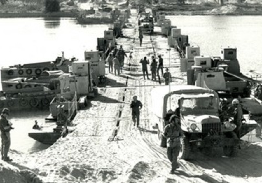 IDF TROOPS cross the Suez Canal, October 1973.