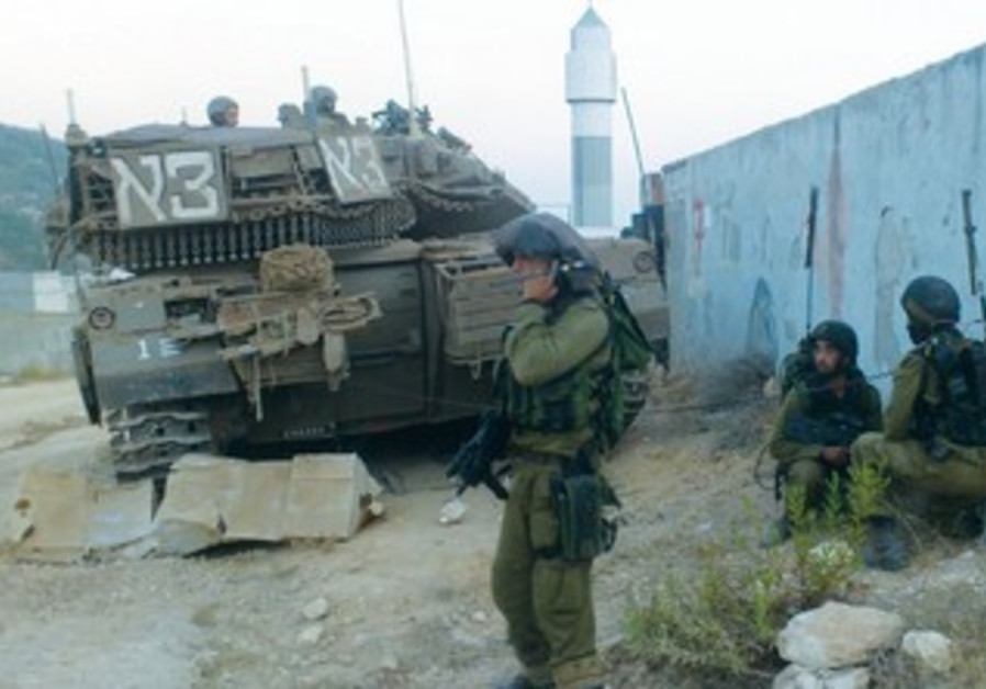 IDF INFANTRY train with tanks providing cover in a built-up area at an army installation in Lachish.