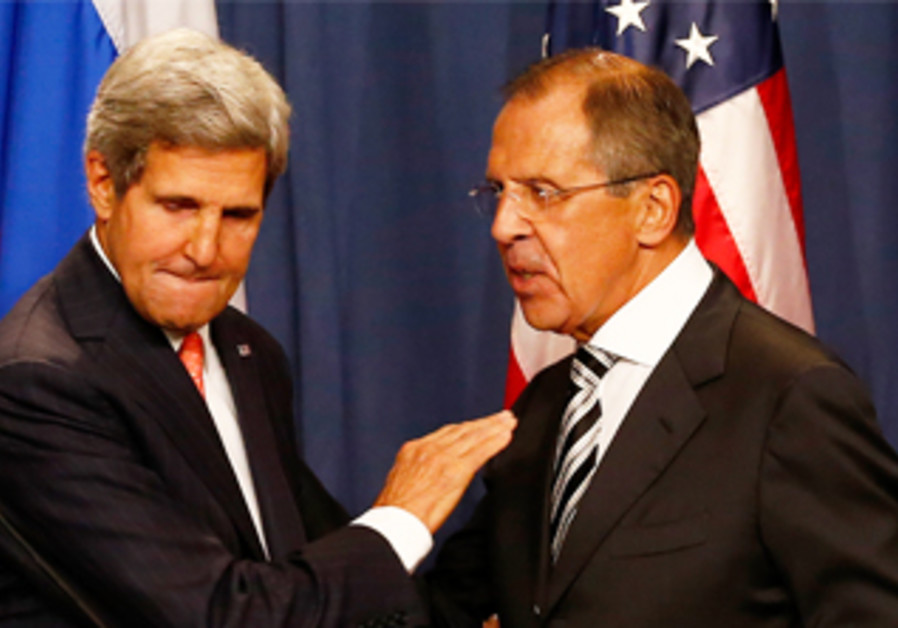 John Kerry and Sergei Lavrov shake hands at a news conference in Geneva, Sept. 14, 2013.